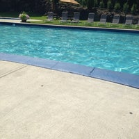 Photo taken at Poolside by Carrie B. on 7/8/2014