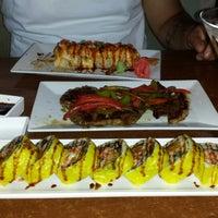 Photo taken at Manu's Tapas Bar & Sushi Lounge by Claudia M. on 7/6/2013
