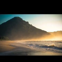 Photo taken at Praia Itamambuca by Elen M. on 3/10/2013