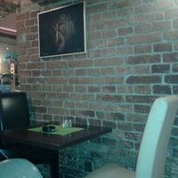 Photo taken at Café 04 by Martina J. on 7/1/2013