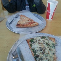 Photo taken at Fellini's Pizza by Cee R. on 12/13/2012