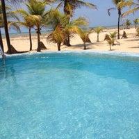 Photo taken at Playa de Boca de Uchire by Aracelis M. on 5/3/2014