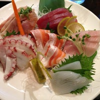 Photo taken at Okura Robata Sushi Bar and Grill by Zoltan K. on 1/9/2013