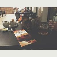 Photo taken at Mélodies Cafe by Nguyen P. on 3/4/2014