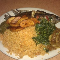 Photo taken at Trinity African Bar & Grill by Femi on 2/18/2013
