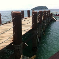 Photo taken at Manukan Island Jetty by Amanda C. on 4/1/2014