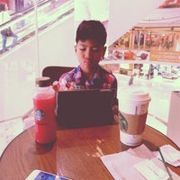 Photo taken at Starbucks 星巴克 by IAN JAY L. on 4/17/2015
