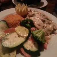 Photo taken at Carlos Miguels by Sandra B. on 1/27/2013