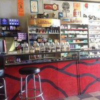 Photo taken at Bogarts Smoke Shop by Kelly H. on 6/25/2014