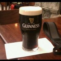 Photo taken at Tigín Irish Pub & Restaurant by Michelle V. on 2/8/2013