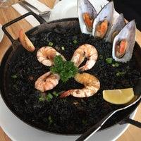 Photo taken at La Cocina Restaurant & Tapas Bar by Vincent C. on 6/21/2015