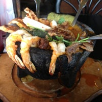 Photo taken at El Pescador by Angie P. on 7/26/2013