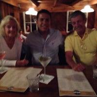 Photo taken at Ninety Nine Restaurant by Jorge S. on 7/6/2014