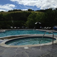 Photo taken at Pool at Grand Mountain Lodge by Christa K. on 7/24/2013