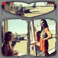 Photo taken at Gate A25 by Tatiana K. on 9/22/2013