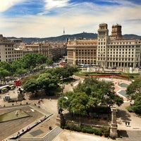 Photo taken at Plaça de Catalunya by Pavel T. on 6/8/2013