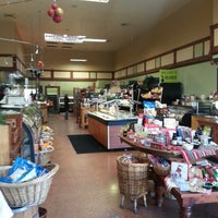 Photo taken at Olives Gourmet Grocer by Evelyn L. on 12/20/2013
