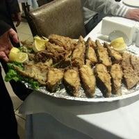 Photo taken at Yalıer Restaurant by Ali D. on 3/25/2013