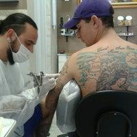 Photo taken at Leandrinho Tattoo by Rafaela M. on 9/6/2013