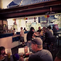 Photo taken at Beach House Bar & Grill by Ian R. on 9/7/2013