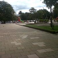 Photo taken at Plaza Italia by Juan B. on 3/4/2013