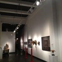 Photo taken at Vermillion Gallery & Wine Bar by Corey K. on 10/18/2012