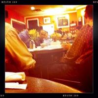 Photo taken at Cafe Rakka by T-Bone C. on 1/8/2011