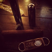 Photo taken at Highland Cigar Co. by Garrett H. on 5/5/2012