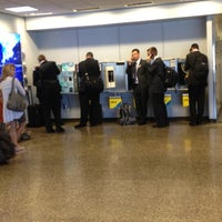 Photo taken at Concourse D by Kim A. on 6/19/2012