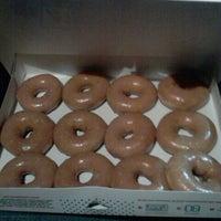 Photo taken at Krispy Kreme Doughnuts by ashley P. on 11/30/2011