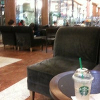 Photo taken at Starbucks by Pauline G. on 6/14/2011