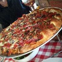 Photo taken at Grimaldi's Coal Brick-Oven Pizzeria by Neema E. on 6/17/2012