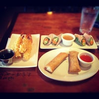 Photo taken at Ginger Red Asian Bistro by Chris M. on 5/14/2012