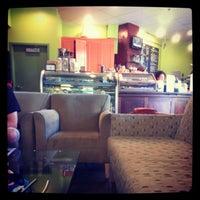 Photo taken at Urban Grind Coffeehouse by Lani P. on 7/12/2012