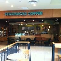 Photo taken at Starbucks by Simon T. on 3/18/2012
