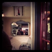 Photo taken at Bistro Petit by Cecilia C. on 12/7/2012