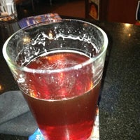 Photo taken at Tilted Kilt Pub & Eatery by Bryan T. on 5/22/2013