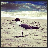 Photo taken at Wrightsville Beach by Chris S. on 7/14/2013
