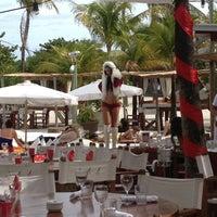 Photo taken at Nikki Beach Miami by Mike S. on 12/23/2012
