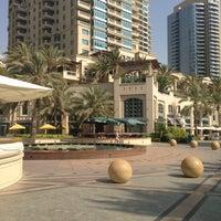Photo taken at Dubai Marina Walk by Nic M. on 6/27/2013