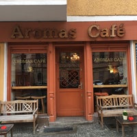 Photo taken at Aromas Café by Ralf H. on 3/6/2016