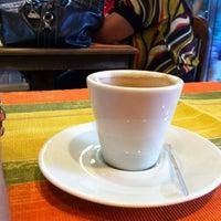 Photo taken at Laranja Café by Gizele T. on 4/15/2013