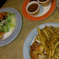 Photo taken at Swiss Chalet by Anna S. on 10/26/2014