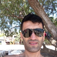 Photo taken at Hayat Bana Güzel Beach by Egemen A. on 6/30/2014