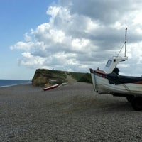 Photo taken at Weybourne Beach by Puteri N. on 5/28/2015