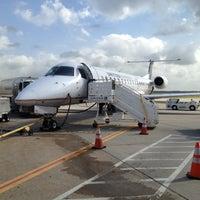 Photo taken at Terminal B by Sam S. on 6/11/2013