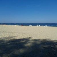 Photo taken at Praia da Barra de Maricá by Michell A. on 6/2/2013