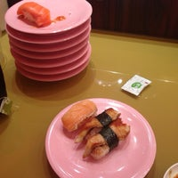 Photo taken at Sushi Express 争鲜回转寿司 by Susan H. on 4/15/2014