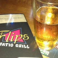 Photo taken at Flips Patio Grill by Richard P. on 9/15/2012