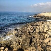 Photo taken at Makronissos beach by Даниил П. on 8/31/2013